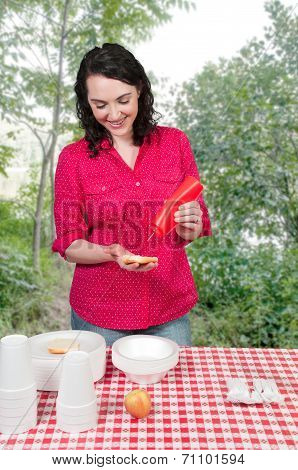 Woman Squeezing Catsup