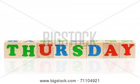Word thursday formed by wood alphabet blocks, isolated on white background