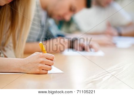 Female hand over paper making notes at seminar