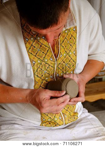 potter, creating an earthen jar.