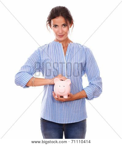 Beautiful Latin Female With Her Piggybank