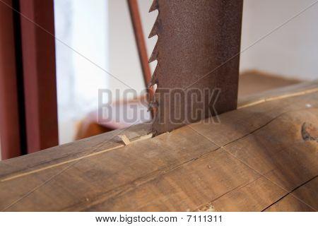 Close Up Of Saw Cutting Wood