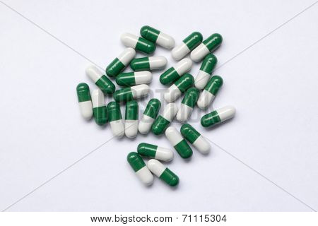 Green and white pills