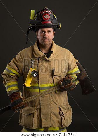 Serious looking confident firefighter Headshot Portrait on Dark Background
