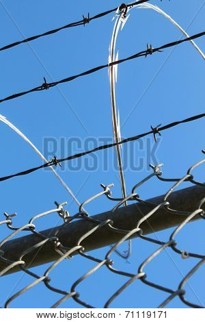Barbwire and razor fence     Save to a Lightbox ?            Find Similar Images     Share ?  Barbwire and metal fence