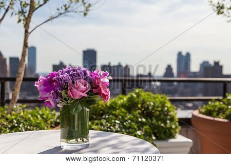 Floral Arangement With Roses, Hydrangea, Orchids With City Background