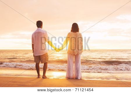 Romantic Mature Couple Enjoying Sunset at the Beach