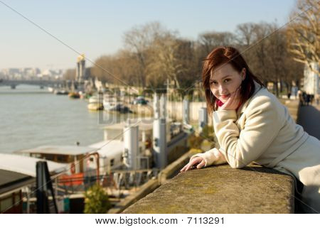 Calm Beautiful Woman In Paris In The Seine Embankment