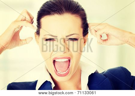 Stressed or angry businesswoman screaming loud , isolated on white