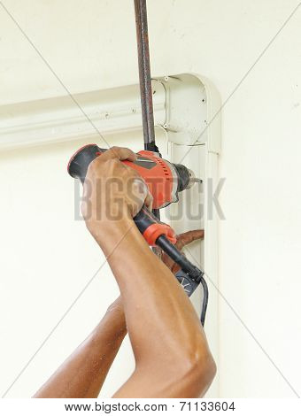 Worker Using Drill