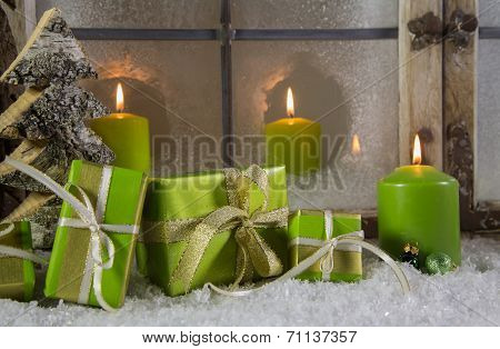 Green Wooden Christmas Decoration With Presents And Candles.