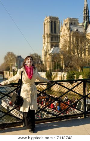 Happy Beautiful Woman In Paris Near Notre-dame De Paris, Enjoying Warm Spring Day