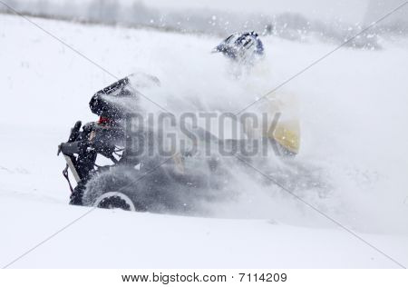 The Quad Bike's Driver Rides Over Snow Track