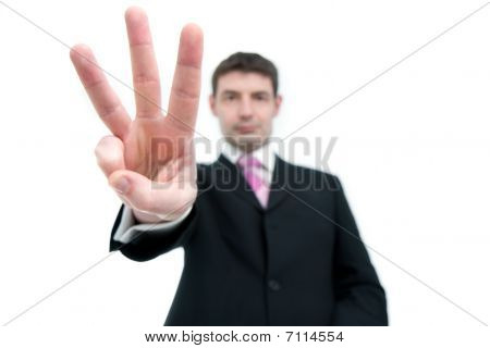 Businessman Holding Up Three Fingers