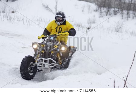 The Quad Bike's Driver Rides Over Snow Track