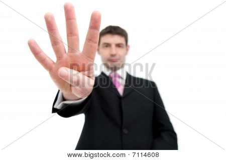 Businessman Holding Up Four Fingers