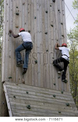Students ascending climbing wall