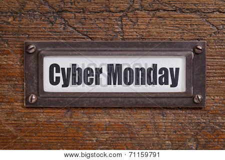Cyber Monday  - file cabinet label, bronze holder against grunge and scratched wood