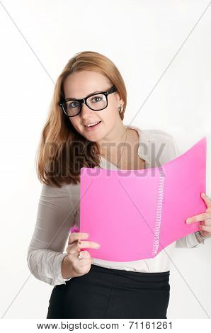 Girl With A Pink Folder On A Light Background