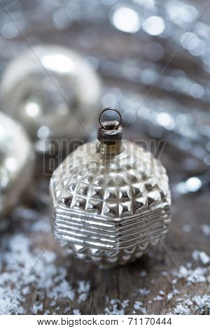 vintage christmas ornaments on a blurred silvery background