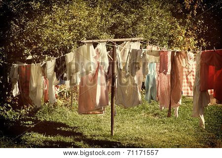 Closeup of a laundry line in a rural setting with a retro instagram look with vignette.