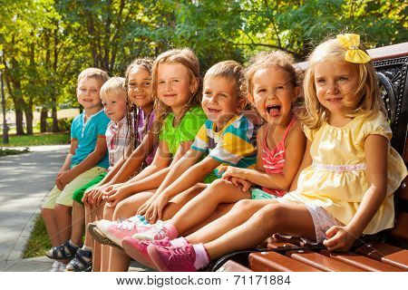 Kids on summer park bench
