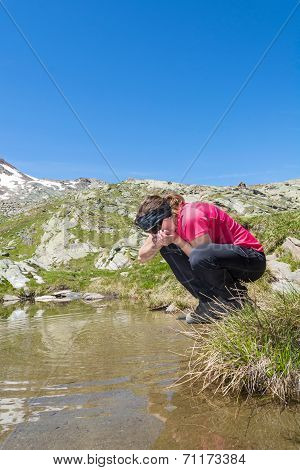 Young Girl Drinking Clean Lake Water