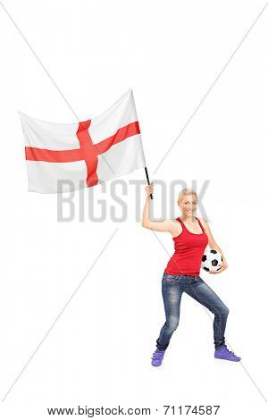 Full length portrait of a female football fan waving an English flag isolated on white background
