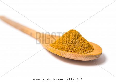 Milled Curcuma On Wooden Spoon