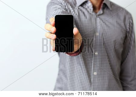 Closeup image of a male hands holding smartphone