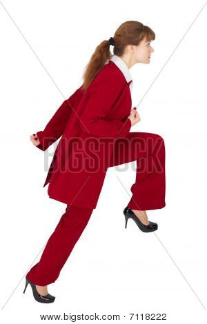 Young Woman In Business Suit Is Moving Forward