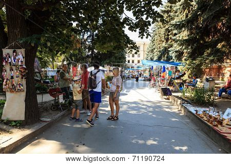 Tourists And Locals Looking At The Stalls At Chisinau Flea Market In Moldova. At The Flea Market One