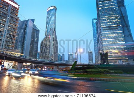 Light Trails On The Modern Building Background In Shanghai China.