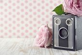 pic of hazy  - Old classic nostalgic box camera with pink roses on vintage shabby chic background - JPG