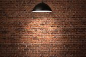 picture of stonewalled  - Grunge red brick wall background illuminated by the ceiling lamp with copy space - JPG