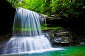 stock photo of virginia  - Bright vivid photo of a waterfall in the back country of West Virginia