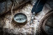 foto of abraham  - vintage  still life with compass on the old map - JPG