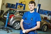 picture of assemblage  - repairman auto mechanic portrait in car auto repair or maintenance shop service station - JPG