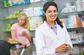 stock photo of cheer  - portrait of cheerful pharmacist chemist woman in pharmacy drugstore - JPG