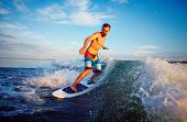 picture of watersports  - Young man surfboarding on summer vacation - JPG