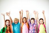 stock photo of diligent  - Ecstatic friends with raised arms looking at camera - JPG
