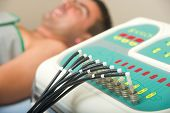 pic of hernia  - Man receiving an electro therapy at the health center - JPG