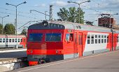 foto of railcar  - Modern red suburban electric train standing at the station in Russia - JPG