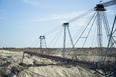 foto of dredge  - a huge working dredge in a mine - JPG
