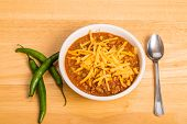 foto of poblano  - A bowl of chili con carne with beans and green chili peppers - JPG