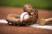 stock photo of baseball bat  - baseball game means the cinder track close