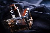 picture of perfume  - The bottle with perfume on black silk - JPG