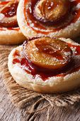 pic of patty-cake  - Cakes of flaky pastry with plums close up on an old table - JPG