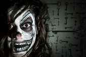 stock photo of clown face  - Teenage girl with scary clown face painting - JPG