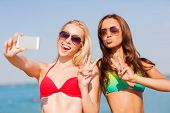 picture of two women taking cell phone  - summer vacation - JPG